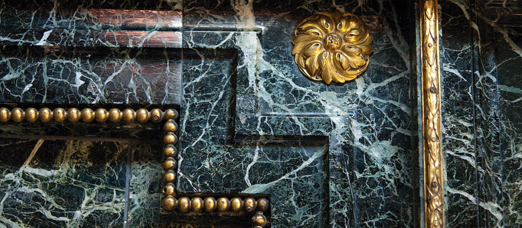 The marble onyx and ormolu fireplace in the library.