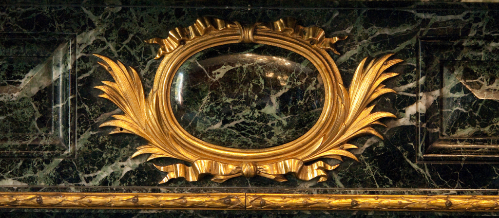 Ormolu detailing of the fireplace
